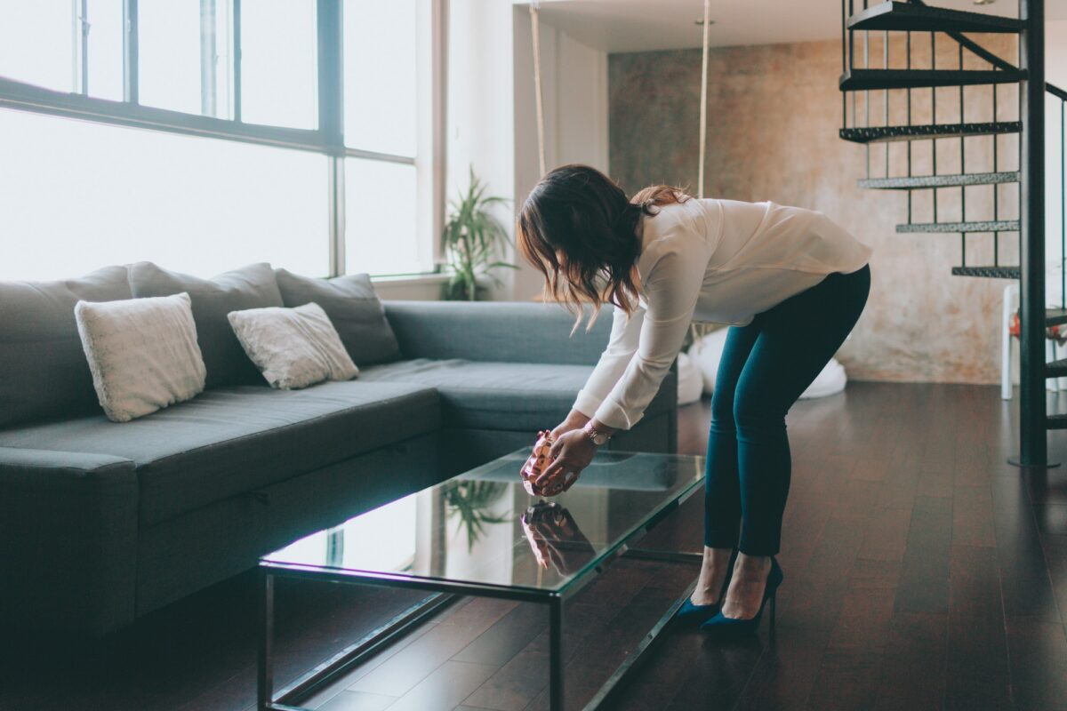 A woman staging a beautiful, modern apartment.