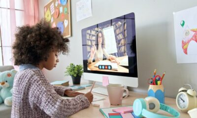 African school kid girl distance learning with online teacher at home.